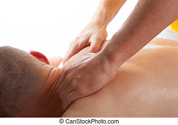 Spine massage - Man with spine diseases has a professional...