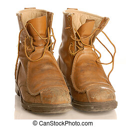 safety boots - worn work boots or safety boots isolated on...