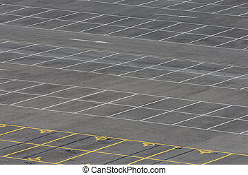 Empty carpark with standard and disables parking bays