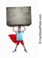 Little Superhero - Little boy lifting a large rock with...