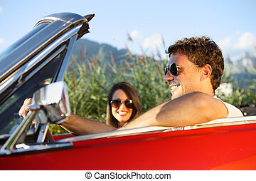 Vintage Car Couple - Beautiful couple enjoying in a...