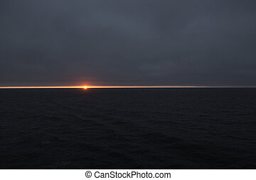 Sunset at sea - Setting sun in the Arctic Circle