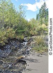 Stream, babbling over the rocks in Yakutia. Ridge...