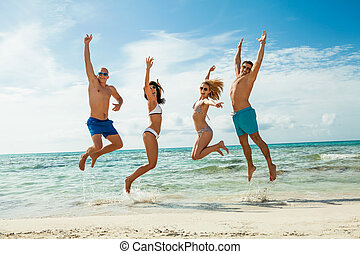 young happy friends havin fun on the beach summer holidays...