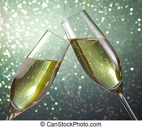 champagne flutes on green light bokeh background - champagne...