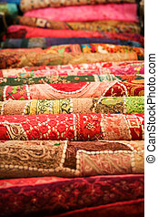 Folded pile of handmade textiles india