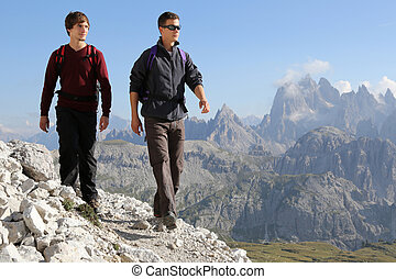 Young men hiking in the mountains