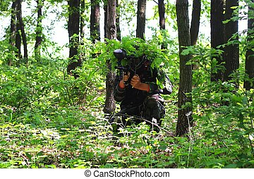 Paintball game in wood