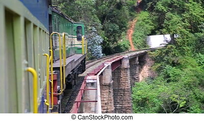 Train crossing railway bridge - Train cautiously crossing...