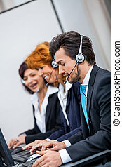friendly callcenter agent operator with headset telephone...