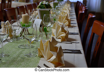 wedding celebration with place setting on the tables and...