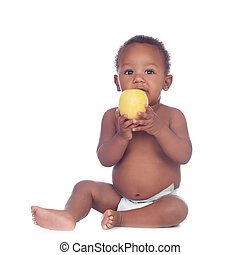 Beautiful african baby diapers eating apple isolated on a...
