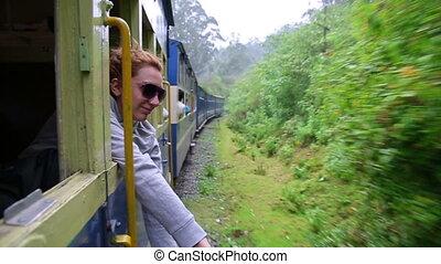 Girl peeking out of train