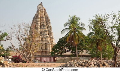 Facade of Hindu temple towering above city