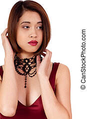 young attractive asian woman with red lips and jewelry isolated