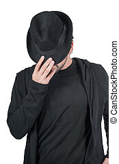 Man covers his face with his hat - Shot of man who covers...