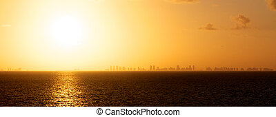 Distant Skyline Sunset - View of the setting sun over the...