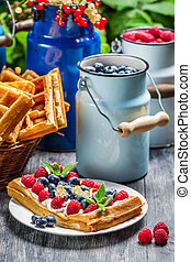 Waffles with berry fruit and whipped cream