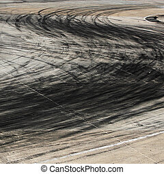 Tire marks on road track - Background with tire marks on...