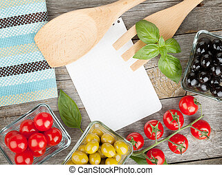 Blank notepad paper for your recipes and food on wooden...