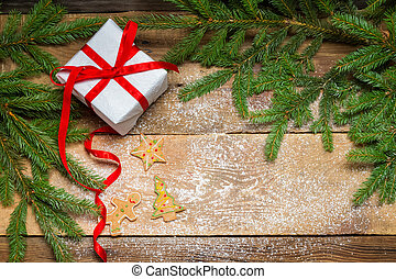 Gingerbread cookies surrounded by spruce and a gift for...