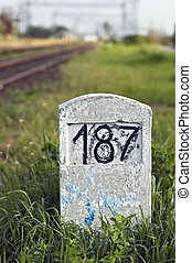 Milestone - Old milestone in the grass