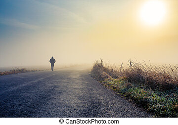 men silhouette in the fog - A person walk into the misty...