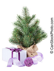 Small christmas tree with decor and gift box. Isolated on...