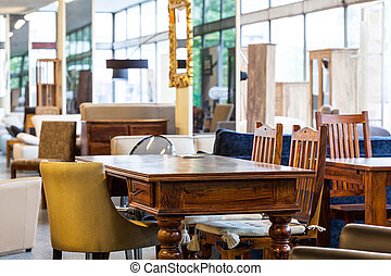 Antique table - An antique table with different chairs