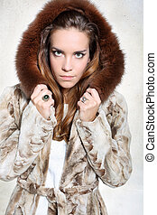 Unhappy woman in luxurious fur coat