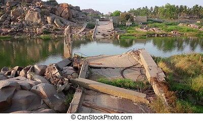 Ruined bridge over calm river