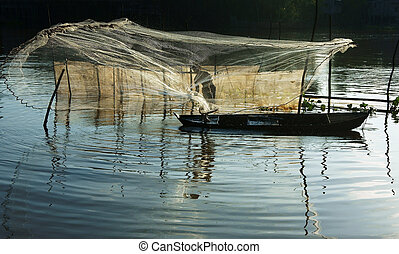 fisherman cast a net on river - Beautiful landcape with...