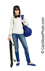 Full-length portrait of teenager with skateboard wearing...