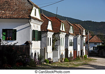 Whitewashed houses in Torocko, Rimetea village Transylvania,...