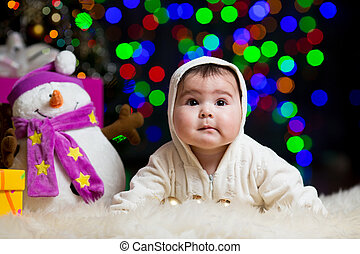 smiling baby girl over Christmas background