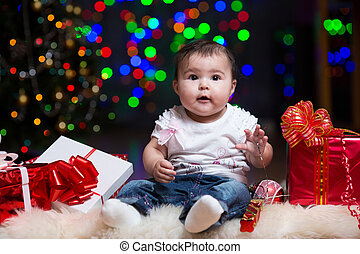 Christmas baby with gifts