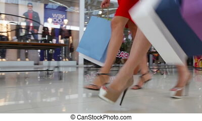 Sale Rush - Close-up of young shopaholics rushing for a sale