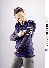 Woman athlete preparing for a run
