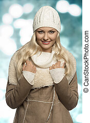 smiling winter girl with wool cap