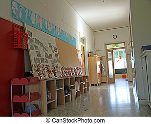 corridor with drawings in a private preschool nursery - long...