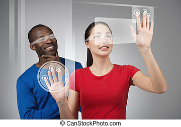 Young woman working on touch screen - Young smiling...
