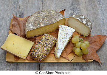 french cheese platter - tray different french cheeses on a...