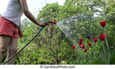 farm woman water hose