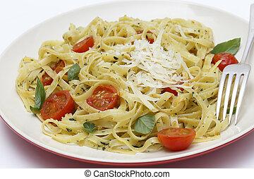 Tagliatelle with pesto tomatoes and fork - Tagliatelle...