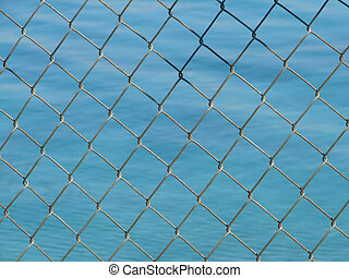 net - steel net with blue sea in background