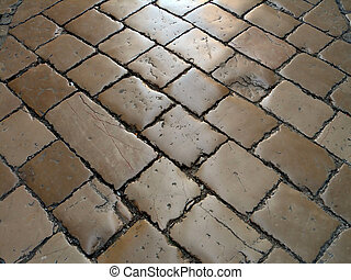 old stone floor - street covered with old stone floor tiles...