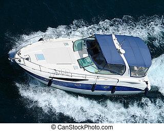 Powerboat - Fast powerboat on dark sea top view...