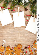 Blank christmas photo frames with fir tree and gingerbread...