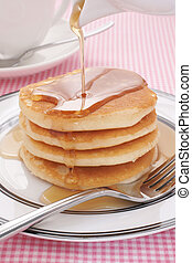 Pancakes and maple syrup - Pouring maple syrup on buttermilk...