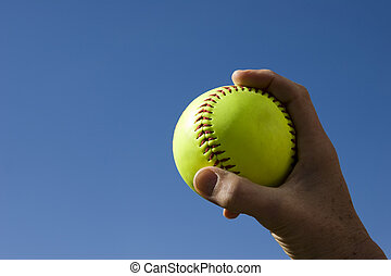 softball with blue sky